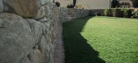 18_nachher_rollrasen_bepflanzung_natursteinmauer